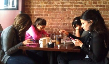 Friends checking phones