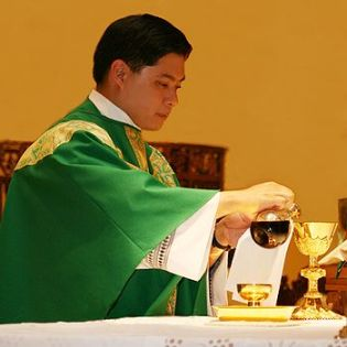 pouring wine at mass